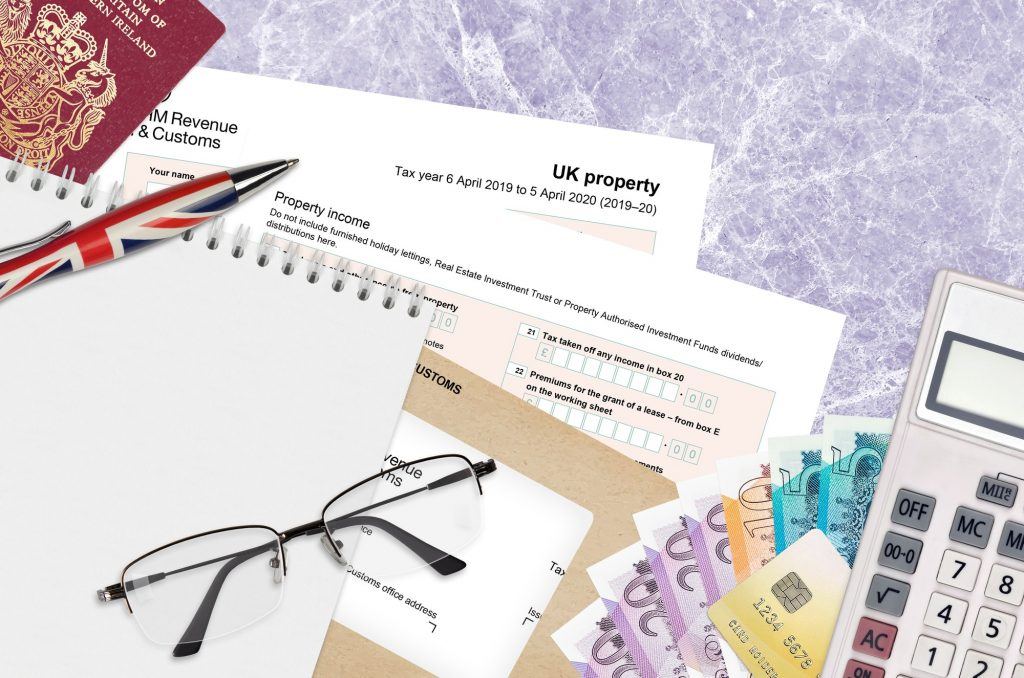 English Tax form sa105 UK Property from HM revenue and customs lies on table with office items