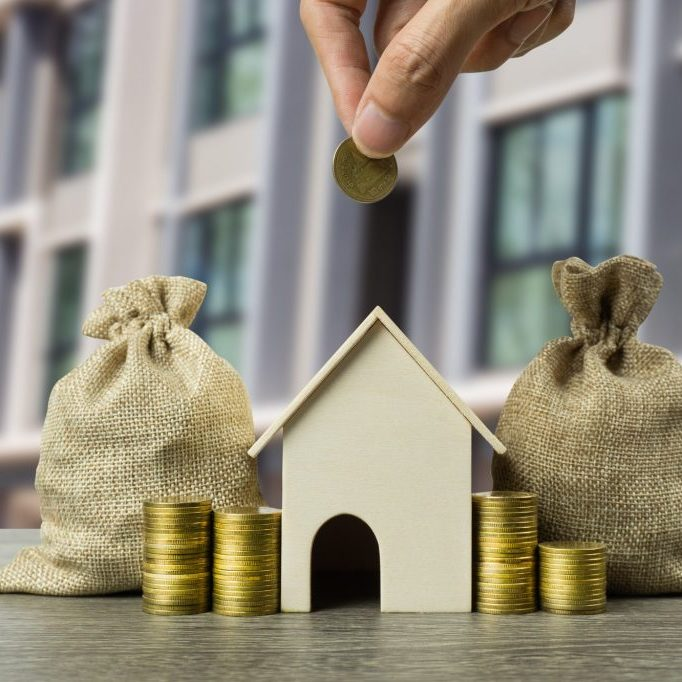 Property investment, savings money for buy new home concepts